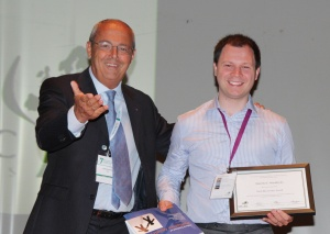 Dr Matthew Maddocks receives his award and prize from Professor Franco De Conno
