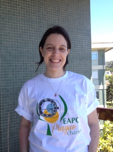 Dr Barbara Gomes wearing her Prague Charter t-shirt