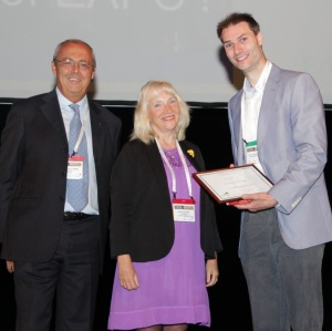 Dr Jeroen Hasselaar (right) receives his award from Professor Sheila Payne and Dr Franco De Conno