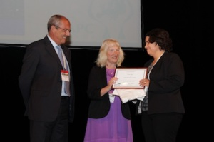 Assistant Professor Meera Agar (right) receiving her award from Professor Sheila Payne and Dr Franco De Conno