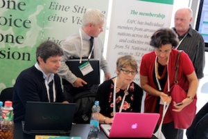 Social media was a prominent topic in casual conversations and at stands in the market place: delegates talking to members of EAPC social media team, Avril Jackson (centre) and Anthony Greenwood (second left)