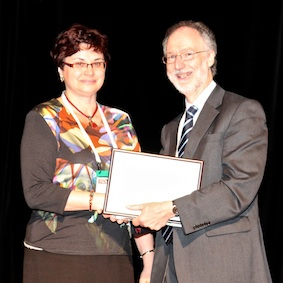 Winner of the Host Country Award for best Czech Poster. Helena Kisvetrová receives her award from David Oliver for her poster: 'Interventions Dying Care and Spiritual Support in Nursing Care for Patients Suffering From Death Anxiety in the Final Phase of Life'