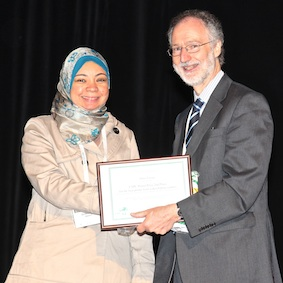 Dina Farag with David Oliver at the awards ceremony. Dina's poster, 'What Concerns the Family Caregivers of Egyptian Palliative Care Patients with Advanced Cancer', was placed joint-second in the Developing Countries category