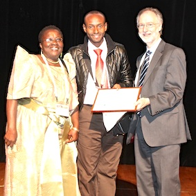 Jack Turyahikayo (centre) and Josephine Kabahweza at the awards ceremony with Dr David Oliver. The prizewinning poster: 'Trends in Morphine Consumption at Mulago Hospital: Impact of an Integrated Hospital-based Palliative Care Service', took first place in the Developing Country category
