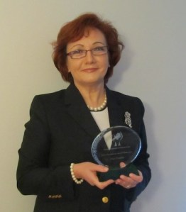 "Dr Olga Usenko with her award: ""... a recognition of the hard work of our group of dedicated professionals."""