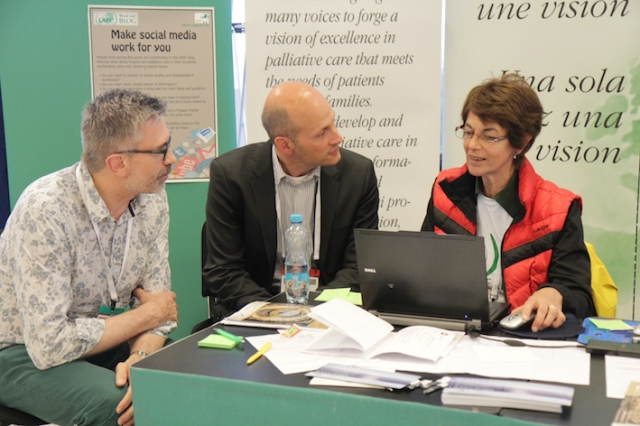 The EAPC stand is a central point for exchanging information. Amelia Giordano (head office) talking to Prof Carlo Leget (Co-chair, EAPC Spiritual Care Taskforce) and Rev Dr Andrew Goodhead of St Christopher's Hospice, UK