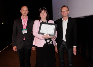 Kathleen McLoughlin with presentation co-chairs: Carlo Leget (right) and Ole Råkjaer