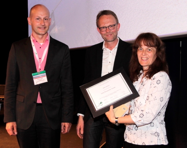 Early Researcher Award presentation: Dr Julie Kinley with co-chairs, Carlo Leget (left) and Ole Råkjaer