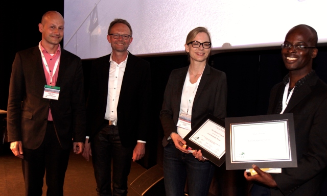Dr Amara Nwosu (right) at the Early Researcher Award presentation Also pictured (from left to right) co-chairs, Carlo Leget and Ole Råkjaer, and joint third-prizewinner,  Tora Skeidsvoll Solheim